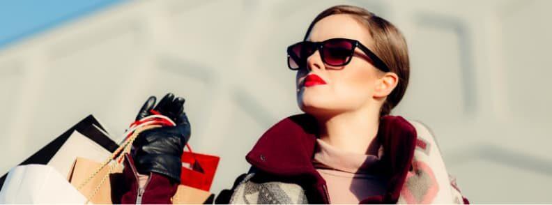 confident solo female traveler shopping