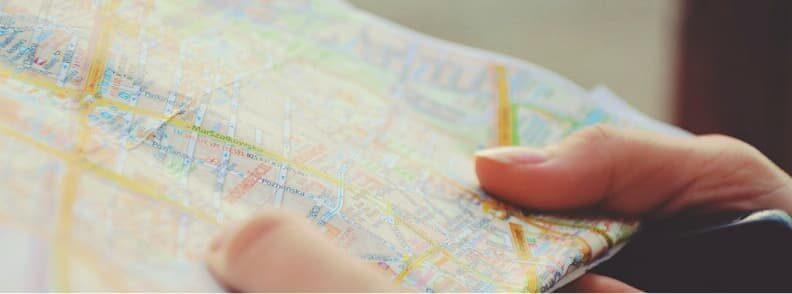 solo female traveler reading map
