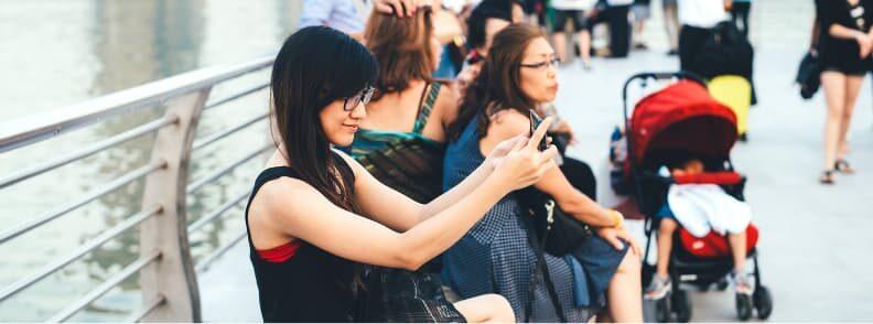 solo female traveler taking a selfie